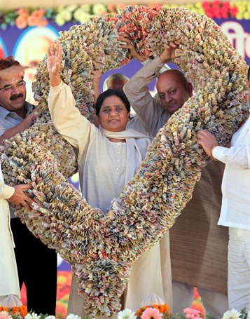 Uttar Pradesh Chief Minister Mayawati receives a garland in Lucknow