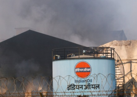 Smoke rises from a depot of state-run Indian Oil Corp (IOC) in Taloja