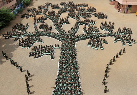 Students in Chennai make a tree formation during a programme to create awareness to save trees