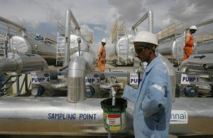 Cairn India employees work at a storage facility for crude oil at Mangala oil field at Barmer in the desert Indian state of Rajasthan August 29, 2009. Cairn India, a unit of U.K.-based Cairn Energy Plc, on Saturday began pumping crude from its Mangala oil field in the Rajasthan block, the first major crude oil discovery in the energy-hungry nation in two decades. REUTERS/Parth Sanyal (INDIA POLITICS ENERGY SOCIETY BUSINESS) BEST QUALITY AVAILABLE - RTR2IWA5