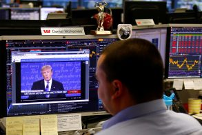 Trader Daniel McNamee talks on the phone on the dealing floor of Australia's Westpac Bank in Sydney, Australia, September 27, 2016, as Republican U.S. presidential nominee Donald Trump is displayed on his screen speaking during the first presidential debate with Democratic U.S. presidential nominee Hillary Clinton.    REUTERS/David Gray     TPX IMAGES OF THE DAY      - RTSPL4I