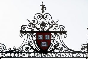 Harvard's seal sits atop a gate to the athletic fields at Harvard University in Cambridge, Massachusetts September 21, 2009.