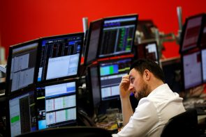 A market maker works on a trading floor in London.