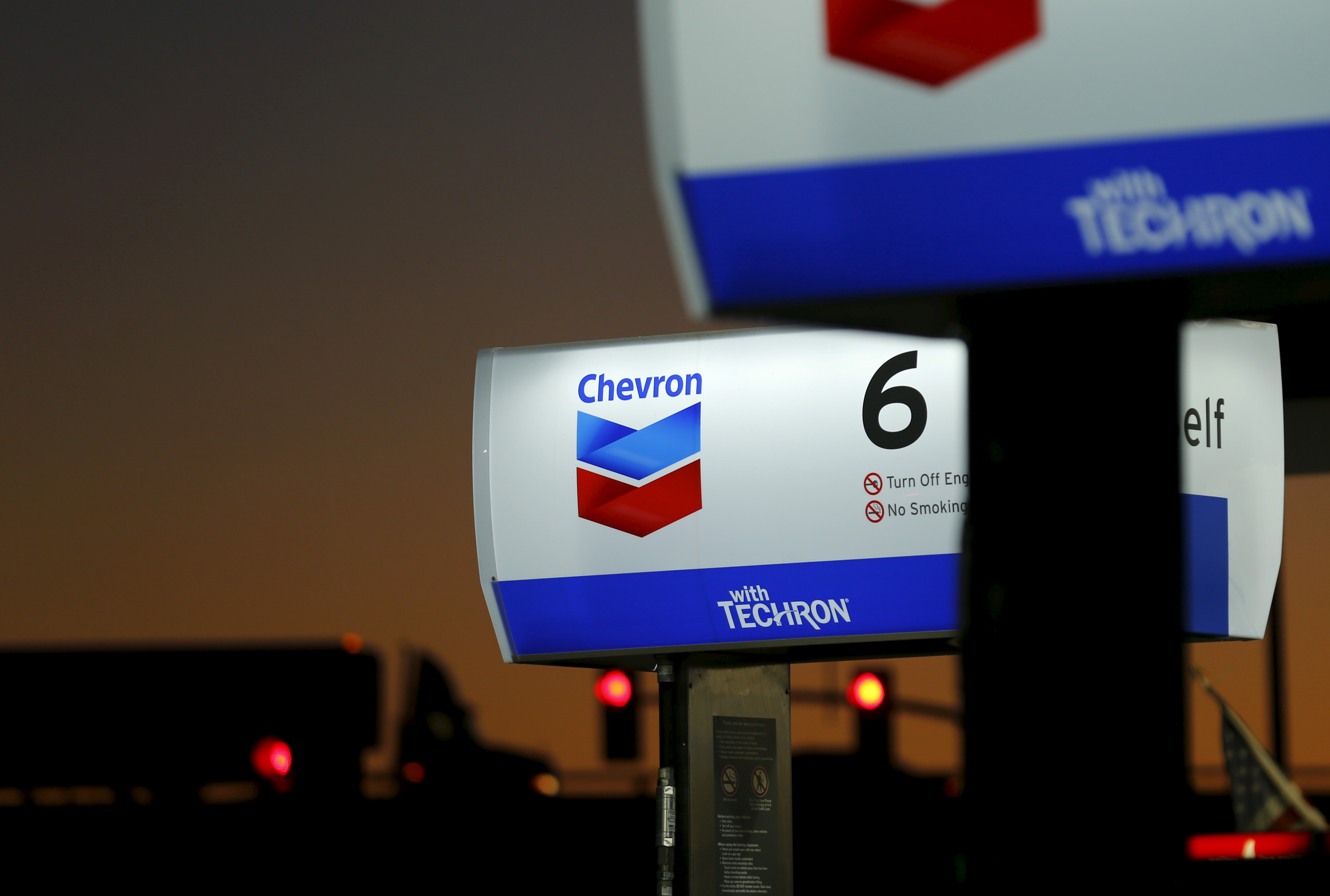 Exxon Mobil profit sinks on weakness in natural gas, chemicals, refining
